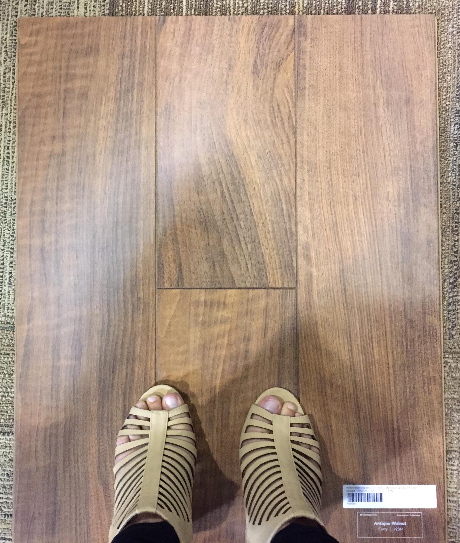 laminate vs vinyl flooring | paradigm interiors